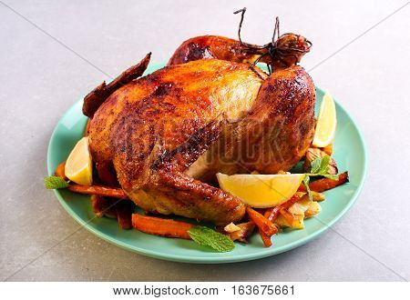 Roast chicken with lemon and honey glaze served with chips and glazed carrot
