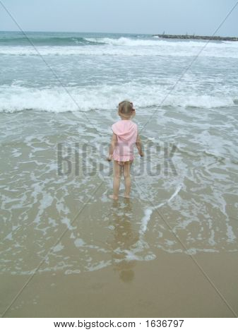 Girl On The Beach Looking At The Waves