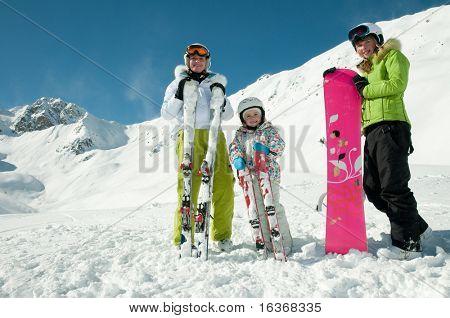 Family winter vacation in ski resort
