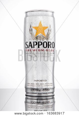 LONDONUK - JANUARY 02 2017: A can of Sapporo Beer with frost on white background. The Japanese brewery was founded in 1876 by German trained brewer Seibei Nakagawa. It is the oldest beer brand in Japan.