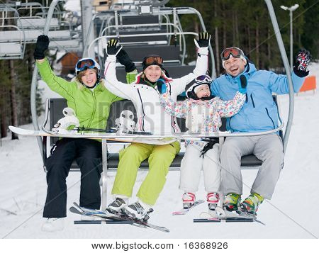 Happy family on ski lift