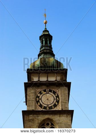 tower with clock over a blue clean sky