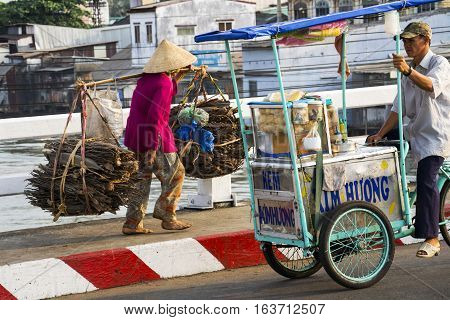 My Tho, Vietnam - February 13: Barefoot Vietnamese Mature Woman In Conical Asian Hat Carrying Wood I