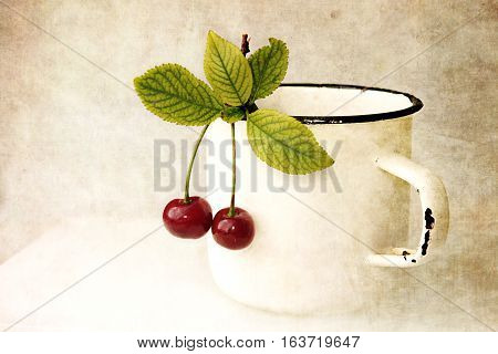 Two Cherry With Leaves Hanging On White Mug