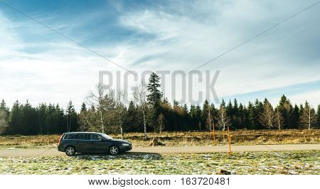 FREUDENSTADT GERMANY - NOV 20 2016: Volvo SUV wagon car parked on mountain top with trees and grass in the background and beautiful blue sky. Volvo is the only car maker that thas the biggest 5 star NCAP test results