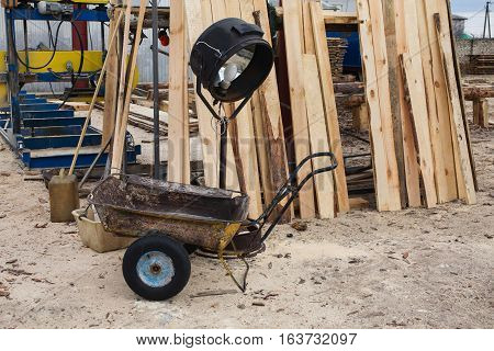 sawmill wood processing timber drying timber harvesting drying boards baulk a wheelbarrow a lamp for drying wood
