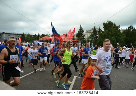 OMSK RUSSIA - AUGUST 07: Marathon runners in action at the Siberian International Marathon on August 7 2016 in Omsk.