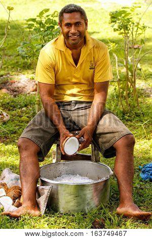 Lavena, Fiji - November 27: Unidentified Man Scrapes Coconuts On November 27, 2013 In Lavena Village
