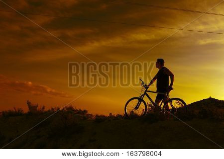 Extreme sports.Mountain bicycle and man.Life style outdoor extreme sport.Sport and healthy life.Mountain bike and landscape background