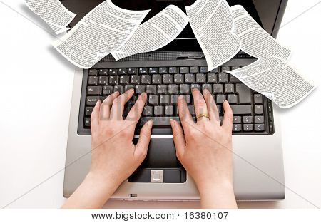 female hands typing on a laptop computer with book pages flying around