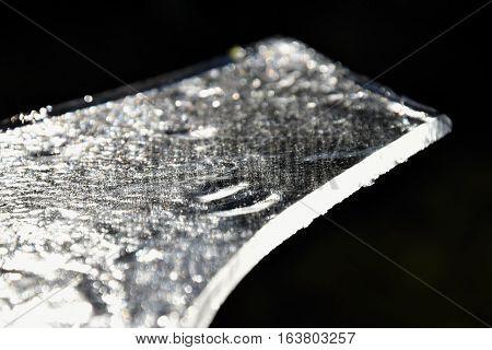 A piece of ice on a dark background. Ice.