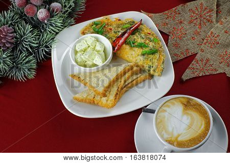 Frittata with chili peppers, toast and coffee