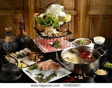 Double favor hot pot soup with wide variety of ingredients