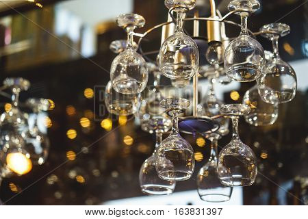 the hanging wine glasses above the bar
