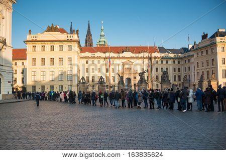 PRAGUE CZECH REPUBLIC - 2.01.2017: People line to Prague Castle on square in Prague Czech Republic