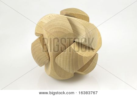 An executive toy / wooden puzzle ball in isolation on a white background. Concept - Work,Rest and Play