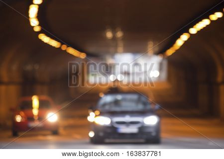 Traffic in tunnel with the car in a motion - defocused image