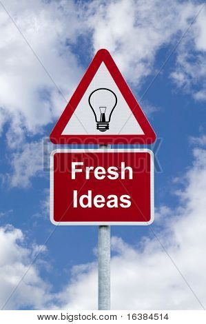 Signpost for 'Fresh Ideas' against a blue cloudy sky, business concept image.