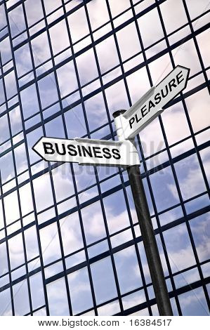Concept image of a signpost with the words Business or Pleasure against a modern glass office building.