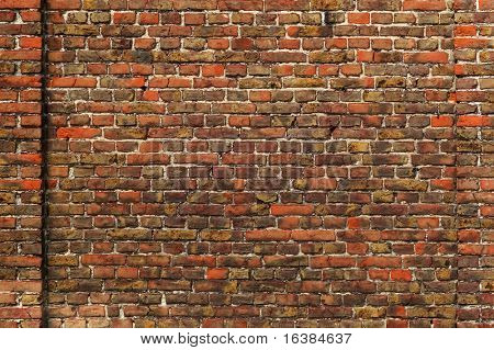 An old brick wall from part of a building that dates back to the 18th centuary.