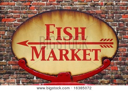 A rusty old retro arrow sign with the text Fish Market