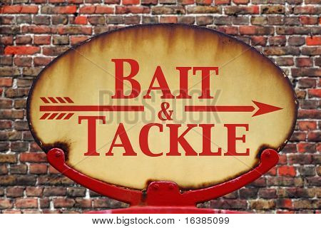 A rusty old retro arrow sign with the text Bait and Tackle