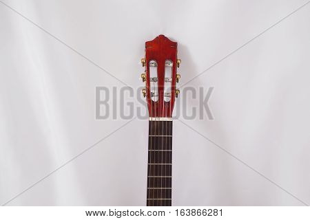 neck of the guitar on a white background musical instrument
