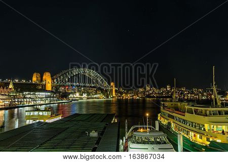 Circular Quay Sydney Australia at night from circular Quay station.JAN 04,2017 Circular Quay area is a popular neighborhood for tourism and consists of walk ways,pedestrian malls,park,Sydney Opera House and Sydney Harbour Bridge.