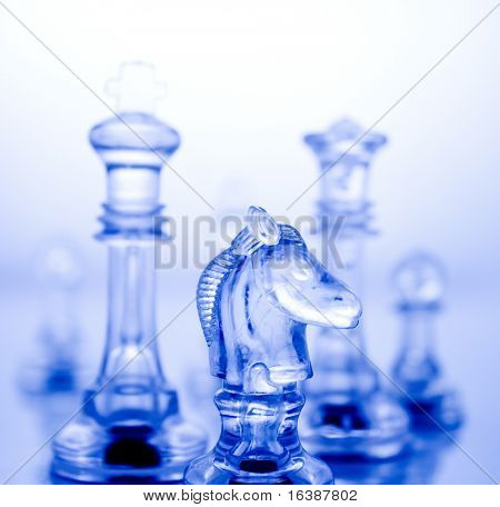 Transparent chess pieces on a blue background