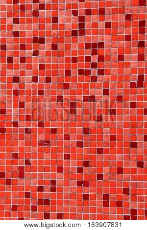 Vertical image of bright and colorful red and orange tiles