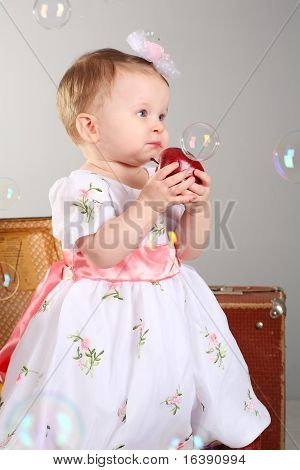 little girl is an apple