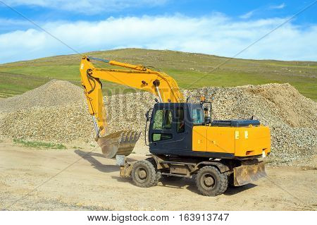 Wheel excavator on the construction of a new road in the steppe zone