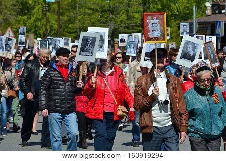 People with portraits of the died relatives participate in demonstration in honor of a Victory Day on May 9 2016. Tyumen Russia.
