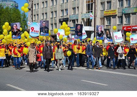 People with balloons participate in demonstration in honor of a Victory Day on May 9 2016. Tyumen Russia.