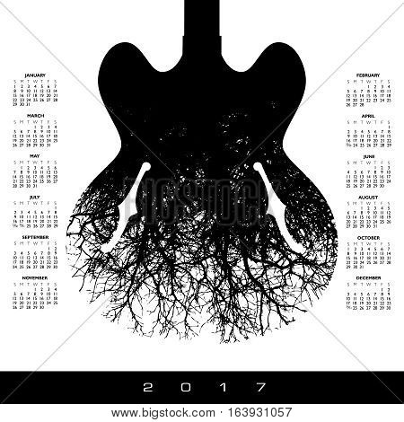 A 2017 calendar with a stunning image of a guitar and tree