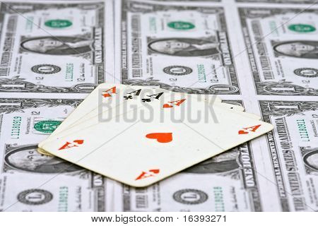playing cards with american money on background