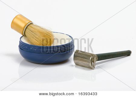 old shaving set on white background