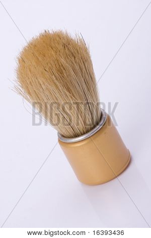 old shaving brush on white background