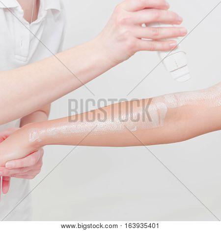 Waxing Woman's Arm