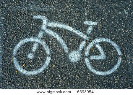 Bicycle lane sign. Bicycle lane sign white bicycle on green pavement background