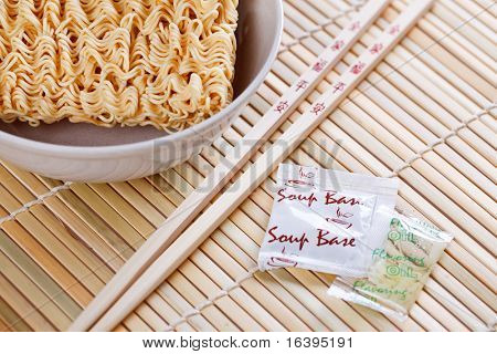 dried chinese noodles and chopsticks on table