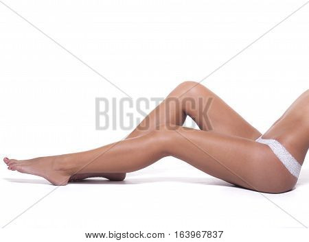 Perfect female legs on a white background.