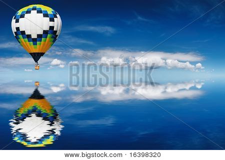 Hot air balloon flying in blue sky