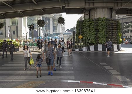 BANGKOK THAILAND - DEC 31 : unidentified people walk across crosswalk near Erawan shrine at Ratchaprasong Junction while new year Festival on december 31 2016 thailand.