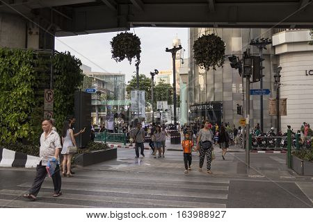 BANGKOK THAILAND - DEC 31 : unidentified people walk across road at Erawan shrine at Ratchaprasong area while new year Festival on december 31 2016 thailand.