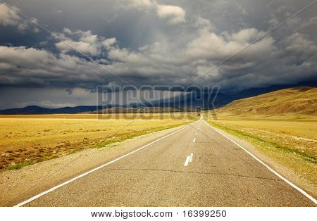 Road to nowhere and storm clouds