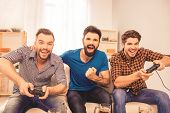 Portrait Of Excited Laughing Men Playing Video Games poster