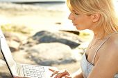 Outdoor Picture Of Blond With Laptop poster