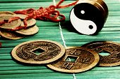 Yin yang, iChing and lucky coins, symbols of oriental meditation and divination