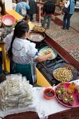 foto of mexican food  - Indian Lady selling fried fish in Janitzio Michoaca Mexico  - JPG